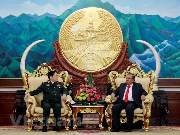 Lao-Viet cung nhau xay dung duong bien gioi hoa binh huu nghi hinh anh 2
