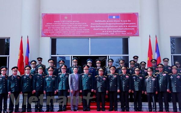 Lao-Viet cung nhau xay dung duong bien gioi hoa binh huu nghi hinh anh 4