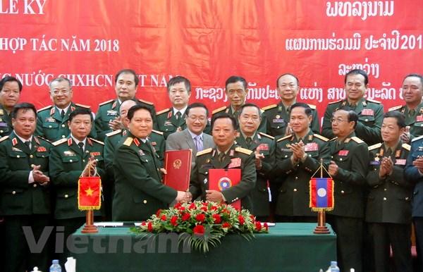 Lao-Viet cung nhau xay dung duong bien gioi hoa binh huu nghi hinh anh 6