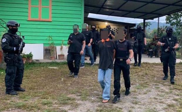 Canh sat Malaysia bat giu 13 nghi pham khung bo hinh anh 1