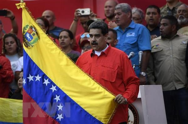 Tong thong Maduro keu goi luc luong vu trang doan ket bao ve dat nuoc hinh anh 1