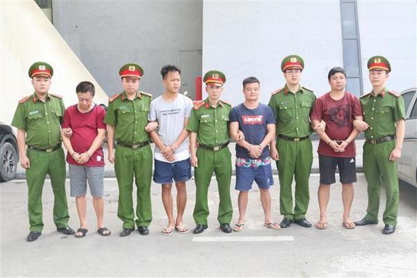 Ban giao bon doi tuong truy na dac biet cho Cong an Trung Quoc hinh anh 1