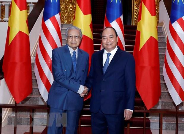 Thu tuong Nguyen Xuan Phuc don, hoi dam voi Thu tuong Malaysia hinh anh 1