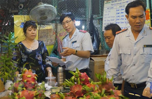 Hang hoa ve cho dau moi tai Thanh pho Ho Chi Minh doi dao cho dip Tet hinh anh 1