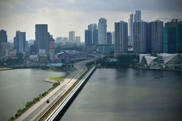 Singapore va Malaysia mo lai duong bien cho di lai thiet yeu hinh anh 1