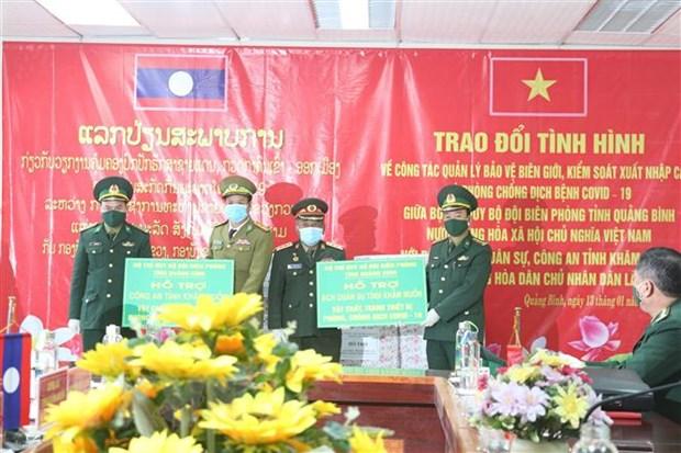 Viet-Lao trao doi ve kiem soat xuat nhap canh va phong, chong dich hinh anh 1