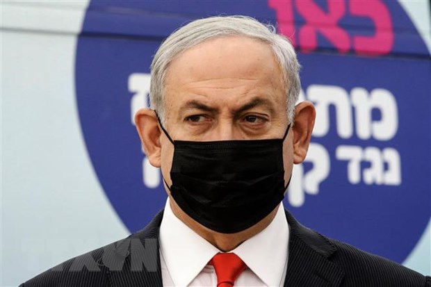 Netanyahu's cult appeared on the scene, with tall women wearing the image 1