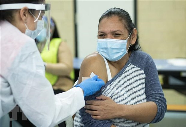 Bang dau tien cua My chung ngua vaccine cho nguoi tu 16 tuoi hinh anh 1