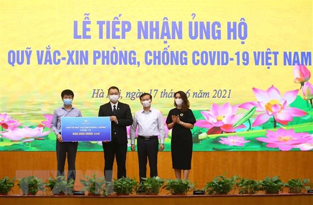 5.772 ty dong da duoc dong gop vao Quy vaccine phong COVID-19 hinh anh 1
