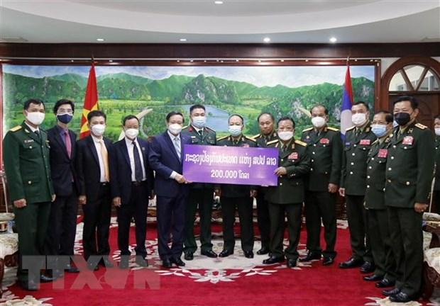 Bo Quoc phong Lao ung ho Quy phong chong COVID-19 Viet Nam 200.000 USD hinh anh 1