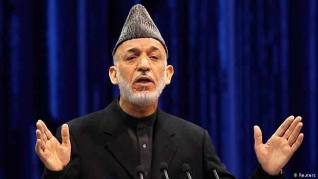 Cuu Tong thong Afghanistan gap mot chi huy cua Taliban hinh anh 1