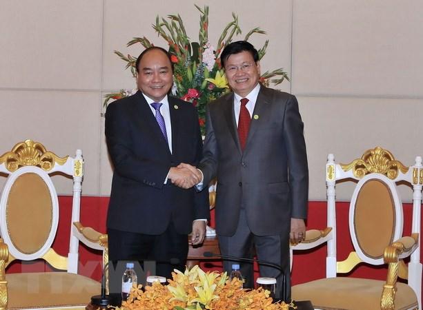 Thu tuong Nguyen Xuan Phuc tiep Thu tuong Lao Thongloun Sisoulith hinh anh 1