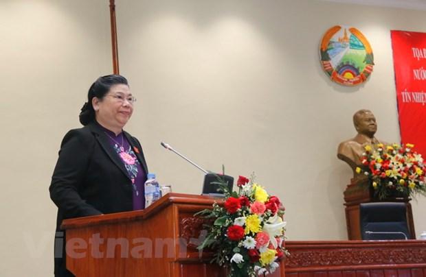 Viet Nam chia se voi Lao kinh nghiem ve lay phieu tin nhiem hinh anh 1
