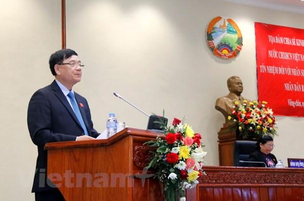 Viet Nam chia se voi Lao kinh nghiem ve lay phieu tin nhiem hinh anh 2