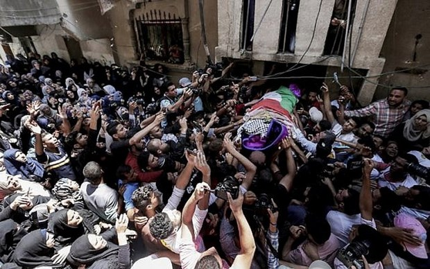 Hang nghin nguoi Palestine du le tang nhan vien y te trung dan Israel hinh anh 1
