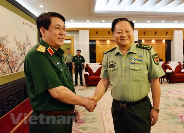 Doan can bo chinh tri cap cao QDND Viet Nam tham huu nghi Trung Quoc hinh anh 1