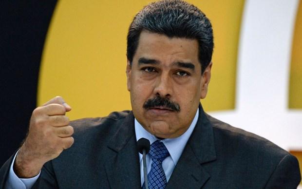 Tong thong Maduro cam ket dap tra neu My can thiep quan su hinh anh 1