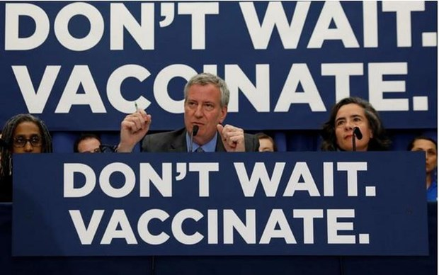 New York quy dinh khong tiem vacxin phong soi bi phat 1.000 USD hinh anh 1