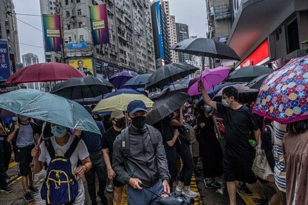 Hong Kong: Hang chuc nghin nguoi bieu tinh phan doi lenh cam che mat hinh anh 1