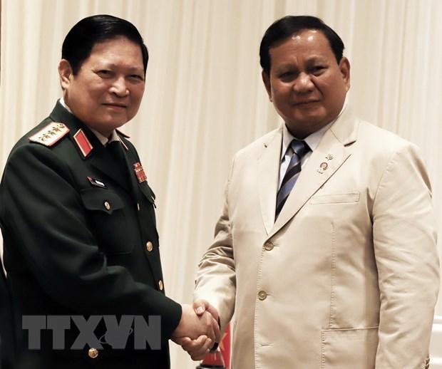 Bo truong Ngo Xuan Lich gap Pho Thu tuong Thai, Bo truong Indonesia hinh anh 1