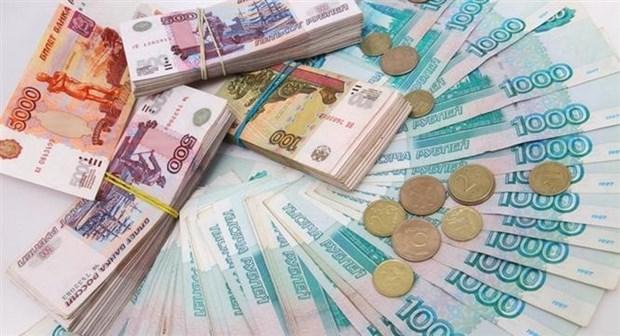 Dong ruble cua Nga giam xuong muc thap nhat trong bon nam hinh anh 1