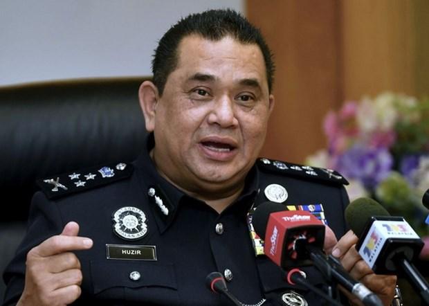 Canh sat Malaysia bat giu nghi can tan cong mang toan cau hinh anh 1
