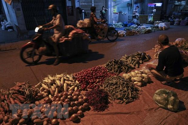 [Photo] Cho dem nong san dip giap Tet Nguyen dan tai Hau Giang hinh anh 1
