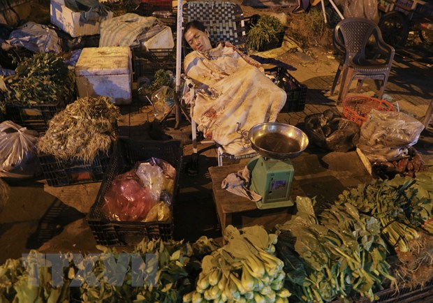 [Photo] Cho dem nong san dip giap Tet Nguyen dan tai Hau Giang hinh anh 6
