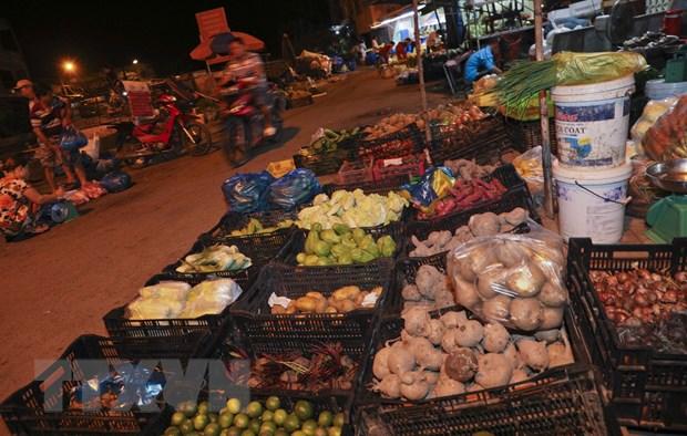 [Photo] Cho dem nong san dip giap Tet Nguyen dan tai Hau Giang hinh anh 7