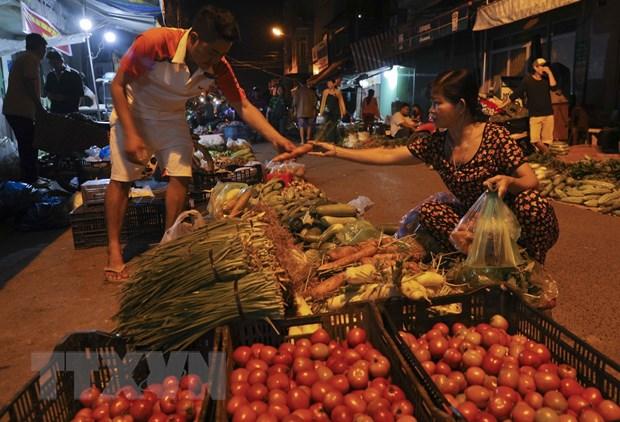 [Photo] Cho dem nong san dip giap Tet Nguyen dan tai Hau Giang hinh anh 8
