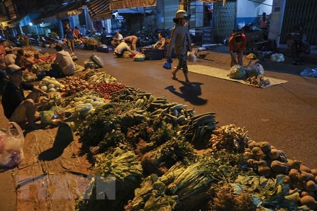 [Photo] Cho dem nong san dip giap Tet Nguyen dan tai Hau Giang hinh anh 9