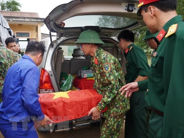 Quang Tri: Tim kiem, cat boc nhieu hai cot liet sy o huyen Dakrong hinh anh 1