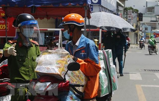 Dich COVID-19: TP Ho Chi Minh siet chat quan ly dich vu shipper hinh anh 1