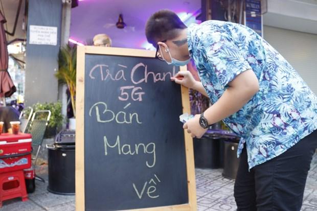Nguoi kinh doanh tai TP Ho Chi Minh chua san sang mo lai cua hang hinh anh 2