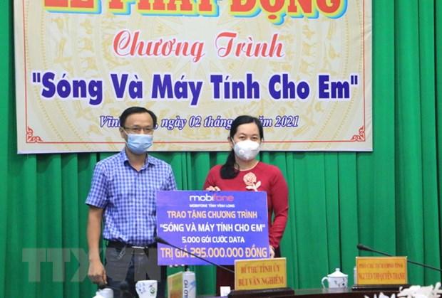 Vinh Long: Gan 1.100 may tinh cho hoc sinh kho khan hoc truc tuyen hinh anh 1