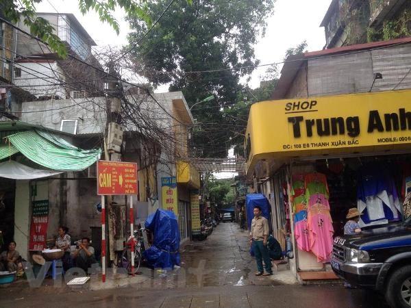 [Photo] Hien truong vu khong che con tin tai khu tap the Thanh Xuan hinh anh 6