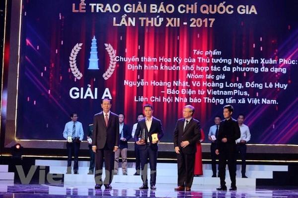VietnamPlus don Huan chuong Lao dong hang Nhi, ra mat san pham chatbot hinh anh 2