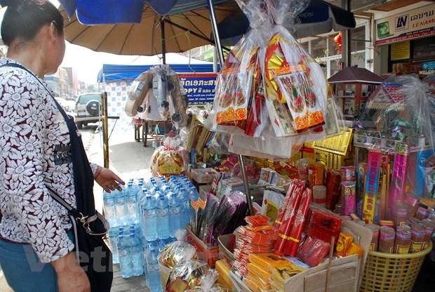 Tet Viet co truyen ron ra Vientiane, am long nhung nguoi con xa xu hinh anh 3