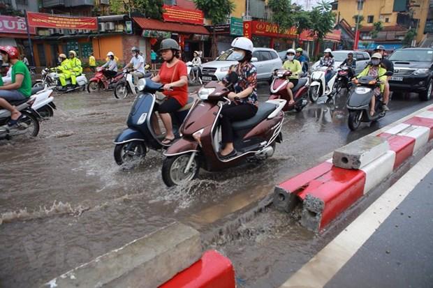 Ha Noi: Do dai phan cach duong Nguyen Chi Thanh de chong ngap hinh anh 10