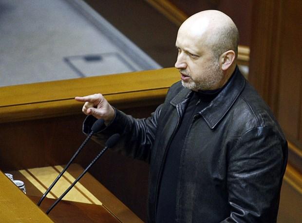 Quoc hoi Ukraine an dinh thoi diem bau cu, Nga len tieng hinh anh 1
