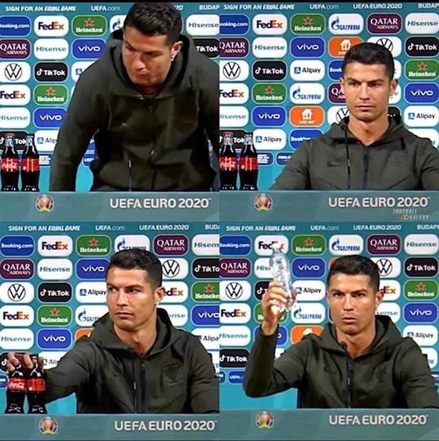 [Video] Cristiano Ronaldo buc tuc vi thay chai Coca o ban hop bao hinh anh 1