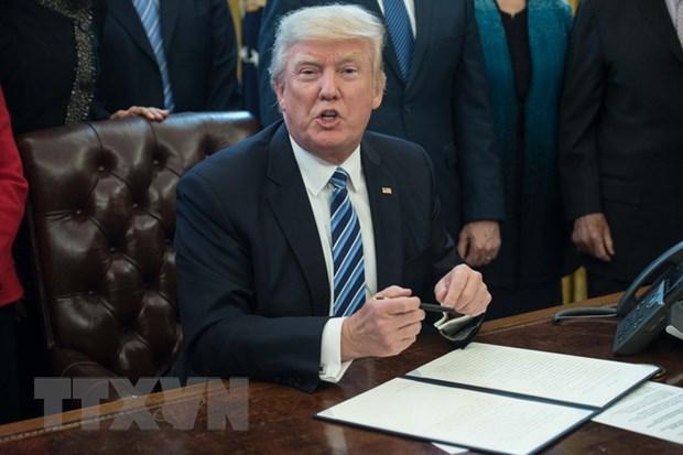 Ong Donald Trump de xuat giam ngan sach chong bien doi khi hau hinh anh 1