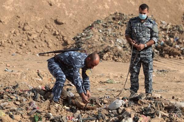 Iraq phat hien mo tap the chon dan thuong va nhan vien an ninh hinh anh 1