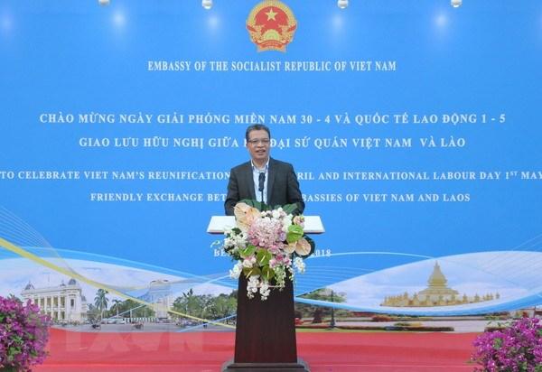 Ky niem 43 nam Giai phong mien Nam va Giao luu Viet-Lao tai Trung Quoc hinh anh 1