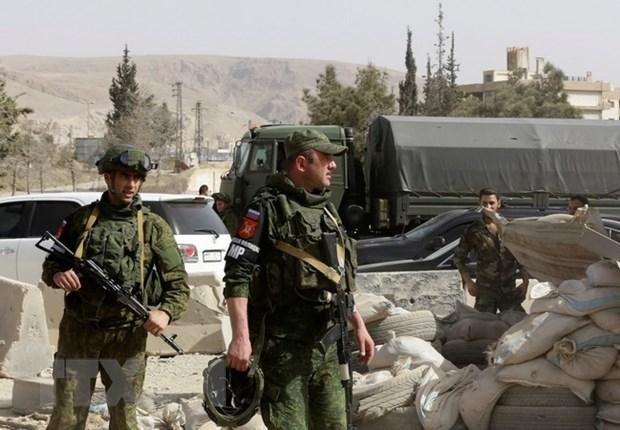 Nga rut hon 1.100 quan nhan va chien dau co khoi Syria hinh anh 1