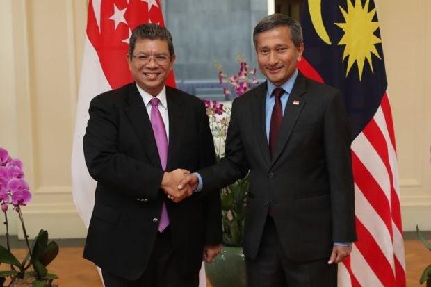 Singapore va Malaysia nhat tri cac bien phap giam cang thang hinh anh 1