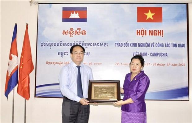 Viet Nam va Campuchia trao doi kinh nghiem ve cong tac ton giao hinh anh 1