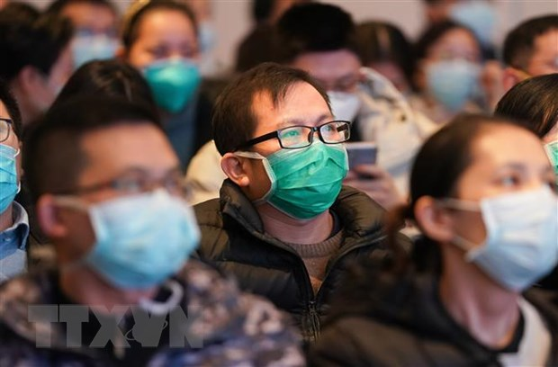 Nhieu tinh o Trung Quoc kich hoat che do khan cap ung pho virus corona hinh anh 1