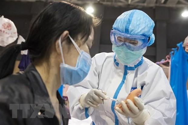 Chuyen gia Trung Quoc tra loi ve kha nang tai nhiem COVID-19 hinh anh 1
