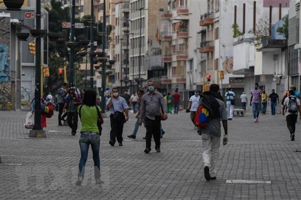 Chinh phu Venezuela va thu linh doi lap hop tac chong COVID-19 hinh anh 1